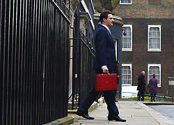 © Licensed to London News Pictures. 20/03/2013. Westminster, UK. Chancellor Of The Exchequer George Osborne poses for photographers whilst holding his red ministerial box outside 11 Downing Street In London, before presenting his annual budget to parliament today 20th March 2013. Photo credit : Stephen Simpson/LNP