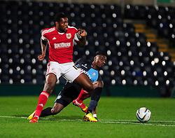 Bristol City's Jay Emmanuel-Thomas is tackled by Wycombe Wanderers' Kortney Hause - Photo mandatory by-line: Joe Dent/JMP - Tel: Mobile: 07966 386802 08/10/2013 - SPORT - FOOTBALL - London Road Stadium - Peterborough - Peterborough United V Brentford - Johnstone Paint Trophy