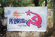 hammer and sickle wall graffiti India, Kerala, a state on the tropical coast of south west India