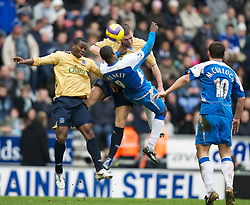 Wigan, England - Sunday, January 21, 2007: Wigan Athletic's Emile Heskey battles with Everton's Alan Stubbs and Joseph Yobo during the Premier League match at the JJB Stadium. (Pic by David Rawcliffe/Propaganda)