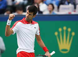 SHANGHAI, Oct. 12, 2018  Serbia's Novak Djokovic celebrates during the men's singles quarterfinal match against Kevin Anderson of South Africa at the Shanghai Masters tennis tournament on Oct. 12, 2018. Novak Djokovic won 2-0. (Credit Image: © Ding Ting/Xinhua via ZUMA Wire)