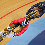 Njisane Nicholas Phillip of Trinidad and Tobago, front, advanced by winning in the quarterfinals of the men's sprint, defeating edward Dawkins of New Zealand at the Velodrome in Olympic Park during the 2012 Summer Olympic Games in London, England, Saturday, August 4, 2012. (David Eulitt/Kansas City Star/MCT)