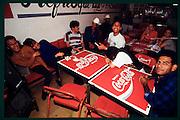 Coca-Cola tables at a bar.