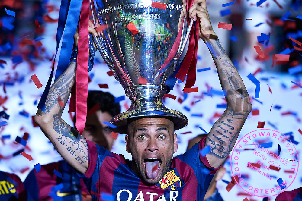 Daniel Alves of FC Barcelona holds trophy while victory ceremony during the 2014/15 UEFA Champions League Final between Juventus and FC Barcelona at Olympiastadion on June 6, 2015 in Berlin, Germany.<br /> Germany, Berlin, June 6, 2015<br /> <br /> Picture also available in RAW (NEF) or TIFF format on special request.<br /> <br /> For editorial use only. Any commercial or promotional use requires permission.<br /> <br /> Adam Nurkiewicz declares that he has no rights to the image of people at the photographs of his authorship.<br /> <br /> Mandatory credit:<br /> Photo by &copy; Adam Nurkiewicz / Mediasport