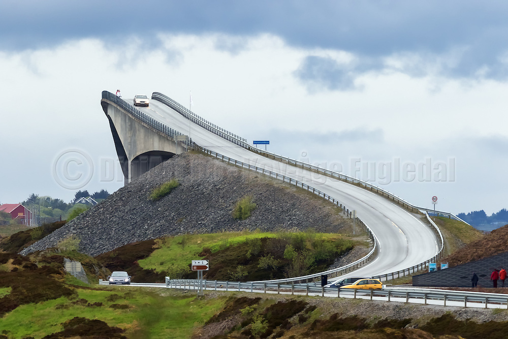 This road looks like the road to heaven, but it is not. The bridge is called Storseisundbrua, and is one of several bridges in a road system named Atlanterhavsveien, located on the west coast of Norway | Dette ser nesten ut som veien til himmelen, men det er den bratte Storseisundbrua, som er en del av Atlanterhavsveien.