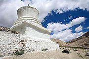 A lone woman is prostrating to a Buddhist Stupa along the Leh-Manali Highway.