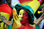 A Ghanian fan with a painted face and body during the 2010 FIFA World Cup South Africa Group D match between Ghana and Germany at Soccer City Stadium on June 23, 2010 in Johannesburg, South Africa.