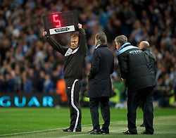 MANCHESTER, ENGLAND - Monday, April 30, 2012: The fourth official indicates five minutes of injury time during the Premiership match at the City of Manchester Stadium. (Pic by David Rawcliffe/Propaganda)