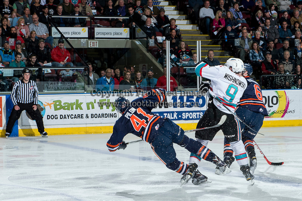 KELOWNA, CANADA - MARCH 25: Tanner Wishnowski #9 of Kelowna Rockets checks Garrett Pilon #41 of Kamloops Blazers on March 25, 2016 at Prospera Place in Kelowna, British Columbia, Canada.  (Photo by Marissa Baecker/Shoot the Breeze)  *** Local Caption *** Tanner Wishnowski; Garrett Pilon;