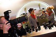 Photokina 2004, World's biggest fair for photography and imaging. Sigma hostesses trying their lenses.