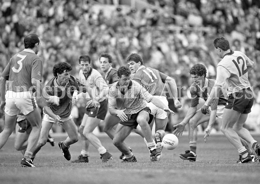 790-630<br /> Leinster Football Final at Croke Park, Dublin v Meath, 29th July 1990:<br /> Vinny Murphy (Dublin, in centre) and Meath's Terry Ferguson (right) go for the ball. Kevin Foley (left) looks on.<br /> Meath 1-14 Dublin 0-14<br /> Pic: Dara Mac Donaill, 29/7/90<br /> (Part of the Independent Newspapers Ireland/NLI Collection)
