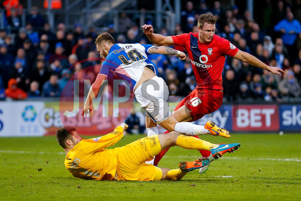 Matt Taylor of Bristol Rovers is challenged by Goalkeeper Scott Flinders of York City who takes a knock to the face in the tackle (as Dave Winfield looks on) - Mandatory byline: Rogan Thomson/JMP - 07966 386802 - 12/12/2015 - FOOTBALL - Memorial Stadium - Bristol, England - Bristol Rovers v York City - Sky Bet League 2.