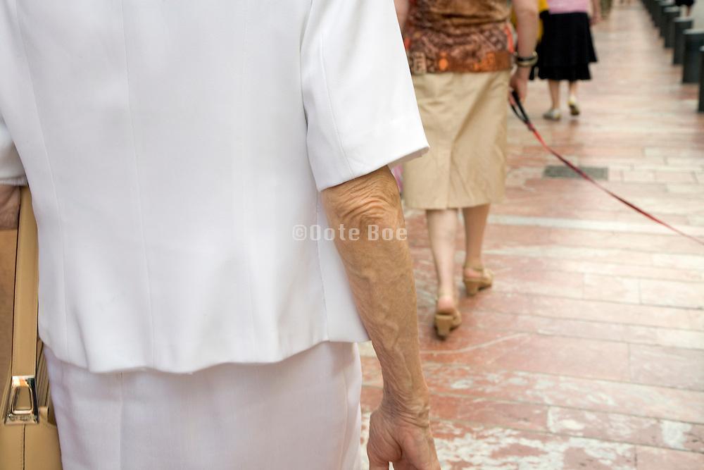 elderly women walking