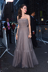 """Newly single Angelina Jolie looks radiant in a strapless pale lavender gown as she stops by the """"First They Killed My Father"""" screening at the DGA theater in Midtown. 14 Sep 2017 Pictured: Angelina Jolie. Photo credit: MEGA TheMegaAgency.com +1 888 505 6342"""