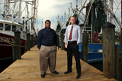 12 April 2012. Biloxi, Mississippi, USA. .Attorney's John Jopling (red tie) and Stephen Teague of the Mississippi Center for Justice. Representing clients for free, the local advocacy law clinic has been relentless in pursuing BP to pay out on obligations to make the community whole again. Yet two years later, thousands of families impacted by the spill continue to await compensation for the loss of their businesses and the overflow of grief the Macondo Well blow out visited upon the region..April 20th is the 2nd anniversary of the spill..Photo; Charlie Varley.