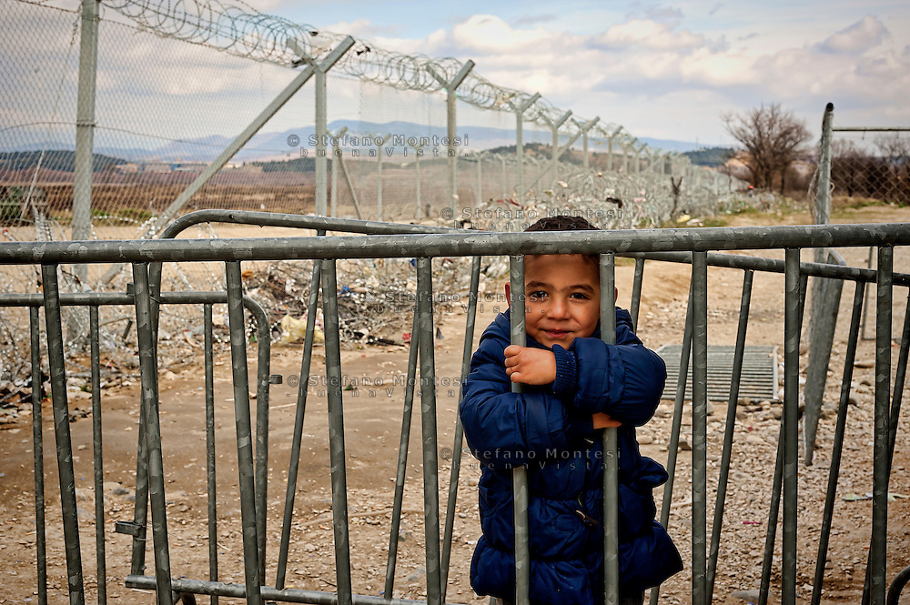 Mohamed a 5 years old Syrian national, waiting to cross  with his family the  Greece-Macedonian border 8 Febraury 2016.<br /> Hundreds of refugees arrive at Idomeni and cross the border between Greece and Macedonian on their journey to North Europe.