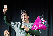 Thomas Raimondi, OMSAR Assistant Director,  waves to the crowd after being crowned the winning contestant for the 2018 Faculty Pageant.