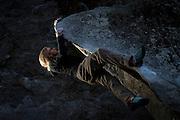 Aaron Livingston on a traverse problem.<br /> Ahwahnee Boulders, Yosemite