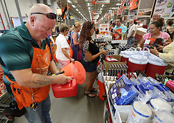 Tom Kepner, left, stocks gas containers as shoppers buy hurricane items at The Home Depot in Lady Lake, FL, USA on Tuesday afternoon, September 5, 2017. Buyers are preparing for Hurricane Irma. The store was out of generators and water early Tuesday. Photo by Stephen M. Dowell/Orlando Sentinel/TNS/ABACAPRESS.COM