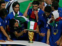 Photo: Glyn Thomas.<br />Italy v France. FIFA World Cup 2006 Final. 09/07/2006.<br /> Marco Materazzi puts an Italy hat on the World Cup.
