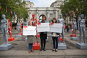 Actresses Imelda Staunton and Jodie Whittaker and Selina Nwulu, young poet laureate for London (centre) launch ActionAid's International Safe Cities for Women Day at Marble Arch, with an interactive exhibition featuring a group of 30 mannequins, London.<br /> Picture date: Thursday May 19, 2016. A third of the mannequins featured in the installation will be marked in red, to represent the one in three women who experience violence in their lifetimes. But behind every statistic is a real woman, and on each mannequin are quotes from women around the world telling their experience of urban violence and the stories behind the statistics. ActionAid is campaigning for the UK government to commit to increasing the proportion of aid going directly to women's groups working on the frontline in poor communities. (photo by Andrew Aitchson/ActionAid)