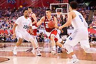 06 APR 2015:  Guard Bronson Koenig (24) of the University of Wisconsin splits Center Jahlil Okafor (15) and Guard Tyus Jones (5) of Duke University during the championship game at the 2015 NCAA Men's DI Basketball Final Four in Indianapolis, IN. Duke defeated Wisconsin 68-63 to win the national title. Brett Wilhelm/NCAA Photos