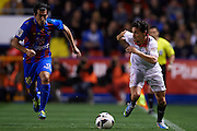 VALENCIA, SPAIN - MARCH 30: (R) Jesus Navas of Sevilla FC  is followed by (L) Pedro Rios of Levante UD during the Liga BBVA between Levante UD and Sevilla FC at the Ciutat de Valencia stadium on March 30, 2013 in Valencia, Spain. (Photo by Aitor Alcalde Colomer).