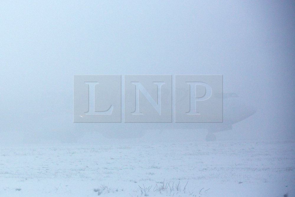 © Licensed to London News Pictures. 04/03/2018. Leeds UK. A Ryanair jet is hardly visible at it prepares for take off in thick fog & sleet at Leeds Bradford airport in Yorkshire this morning. Photo credit: Andrew McCaren/LNP