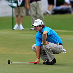 2009 April 26: Kevin Streelman of Wheaton, IL lines up a putt on the 17th hole during the final round of the Zurich Classic of New Orleans PGA Tour golf tournament played at TPC Louisiana in Avondale, Louisiana.