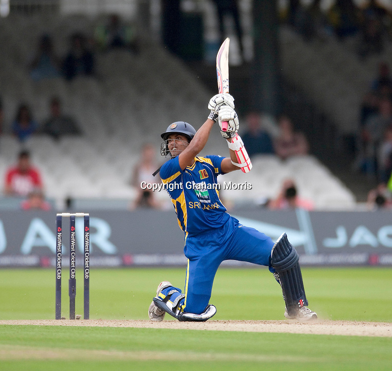 Dinesh Chandimal his the winning runs during his century in the third one day international between England and Sri Lanka at Lord's, London. Photo: Graham Morris (Tel: +44(0)20 8969 4192 Email: sales@cricketpix.com) 03/07/11