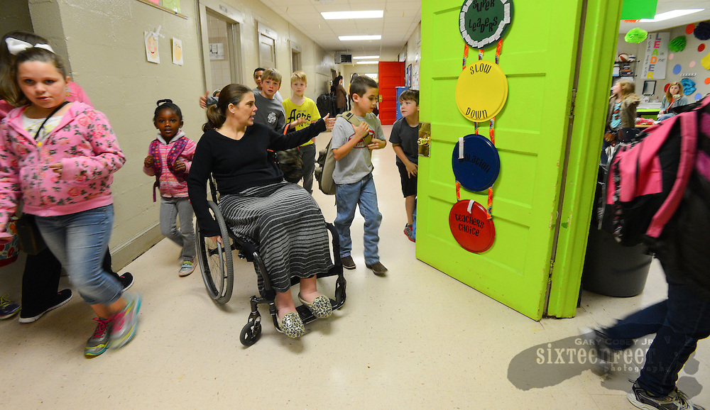 Gary Cosby Jr./Decatur Daily    Courtney Carpenter Boyll was a rising star athlete in 1994 when a car wreck left her paralyzed.   Twenty years later she is a wife, mother of three and third grade teacher and does it all as a paraplegic.  Courtney hustles her third graders into class at Moulton Elementary School.