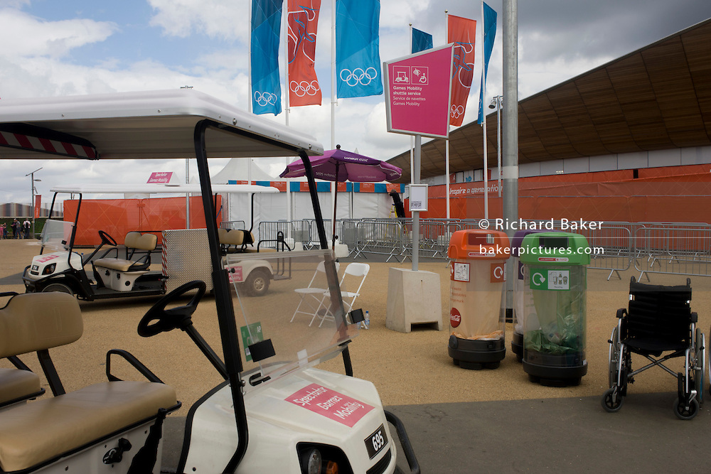 A landscape of facilities and equipment outside the curved wooden roof of the iconic Velodrome during the London 2012 Olympics. The final bill for the 2012 Olympics could be ten times higher than the original estimate, according to an investigation. The predicted cost of the games when London won the bid in 2005 was £2.37billion. That figure has now spiralled to more than £12billion and could reach as much as £24billion, the Sky Sports investigation claims. The Olympics public sector funding package, which covers the building of the venues, security and policing, was upped to around £9.3bn in 2007. This land was transformed to become a 2.5 Sq Km sporting complex, once industrial businesses and now the venue of eight venues including the main arena, Aquatics Centre and Velodrome plus the athletes' Olympic Village.