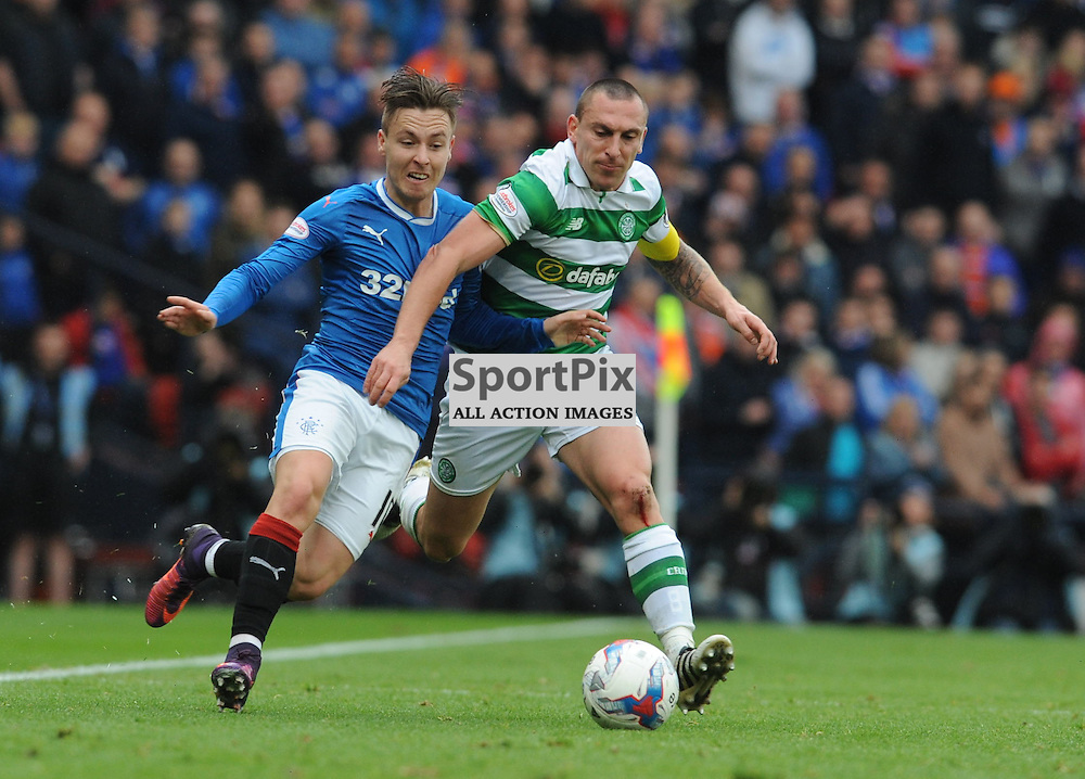 Barrie McKay and Scott Brown battle for the ball in the match between Rangers v Celtic, Betfred Cup semi-final, Hampden Park, Sunday 23 October 2016, (c) Angie Isac | SportPix.org.uk