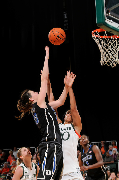 Haley Peters #33 of Duke shoots over Shawnice Wilson #40 of Miami during the NCAA basketball game between the Miami Hurricanes and the Duke Blue Devils at the Bank United Center in Coral Gables, FL. The Hurricanes defeated the Blue Devils 69-65.