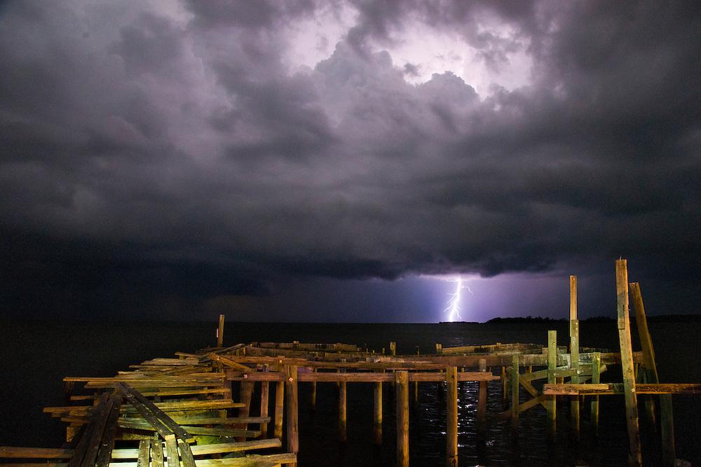 Storm over Atsena Otie Key from Seabreeze Restaurant dock.