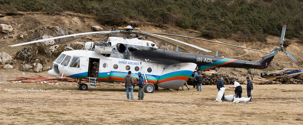 Shree Airlines helicopter. On a hill overlooking Namche Bazaar, Shyangboche Airstrip (3750 meters or 12,303 feet) can be reached by helicopter but is generally not used by fixed wing aircraft due to the loose pebble surface. Many trekkers get up before sunrise and walk up to the Sagarmatha National Park Headquarters near here to take in the impressive views of Mount Everest, Lhotse, Thamserku, Ama Dablam (6856 m or 22,493 ft). Sagarmatha National Park (created 1976) was honored as a UNESCO World Heritage Site in 1979.