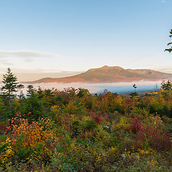 Fog and Mount Katahdin at dawn in Maine's Katahdin Woods and Waters National Monument.