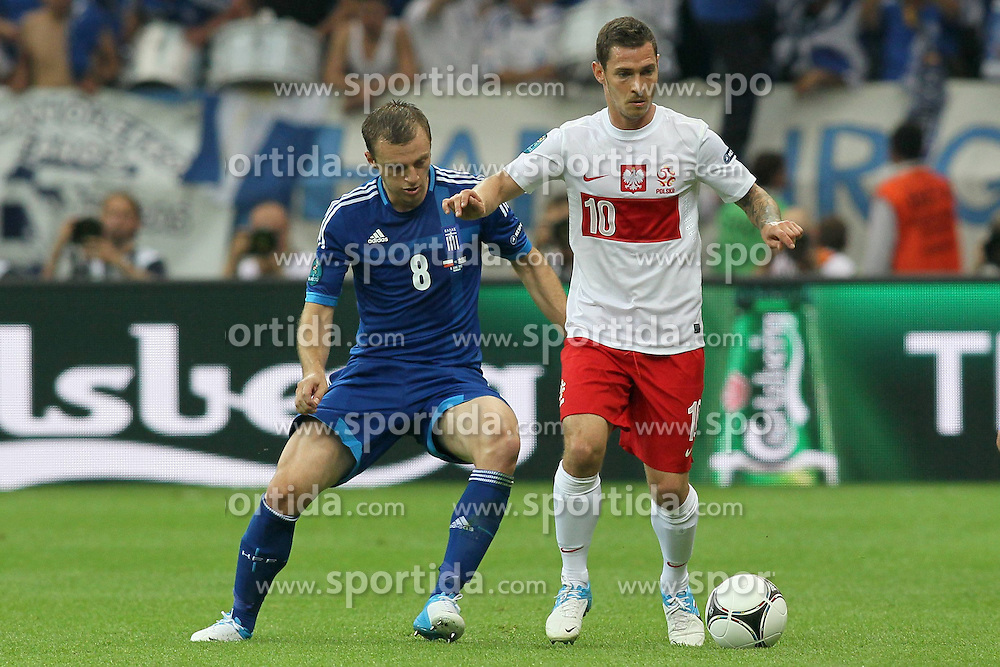 08.06.2012, Nationalstadion, Warschau, POL, UEFA EURO 2012, Polen vs Griechenland, Gruppe A, im Bild AVRAAM PAPADOPOULOS (L) LUDOVIC OBRANIAK (P) // during the UEFA Euro 2012 Group A Match between Poland and Greece at the National Stadium Warsaw, Poland on 2012/06/08. EXPA Pictures © 2012, PhotoCredit: EXPA/ Newspix/ Mateusz Trzuskowski..***** ATTENTION - for AUT, SLO, CRO, SRB, SUI and SWE only *****