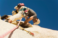 Man Climbing on Cliff view from below (low angle view)