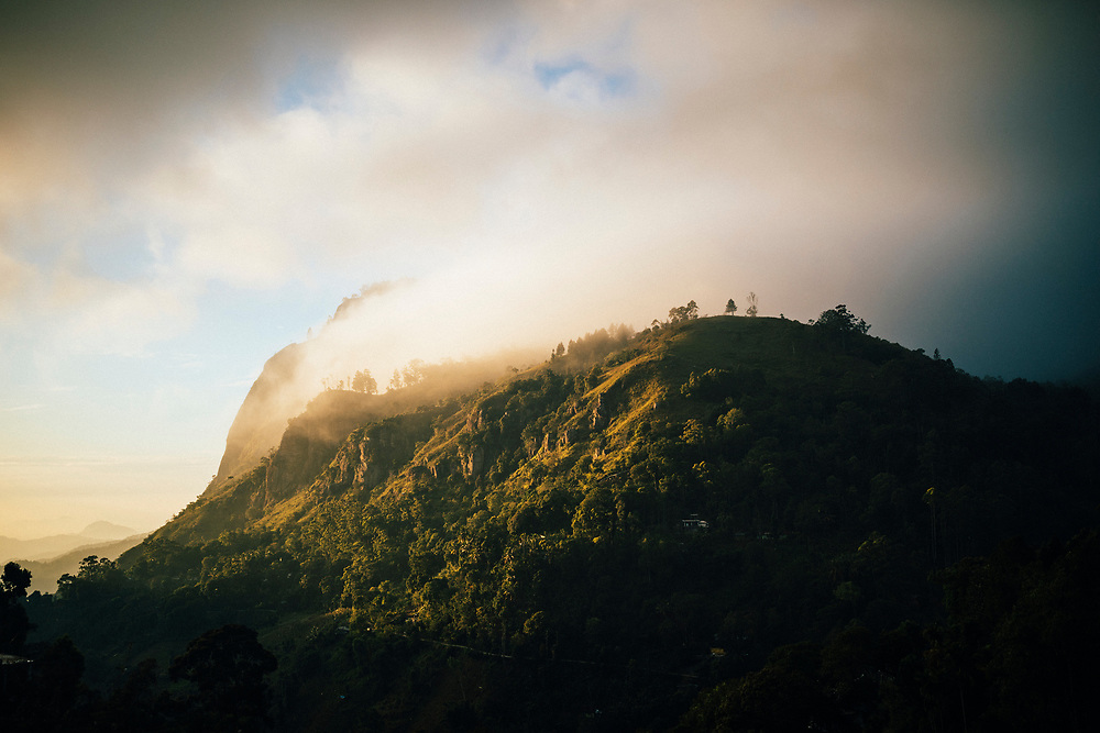 Ella, Sri Lanka -- February 2, 2018: Morning sun and mist on the mountains of hill country.