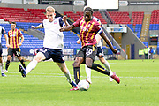 Bradford City forward Clayton Donaldson challenged by Bolton Wanderers defender Harry Brockbank during the EFL Trophy match between Bolton Wanderers and Bradford City at the University of  Bolton Stadium, Bolton, England on 3 September 2019.