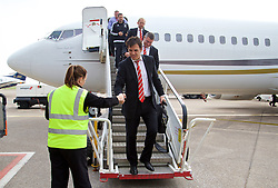 CARDIFF, WALES - Sunday, October 11, 2015: Wales' manager Chris Coleman steps off the team plane as the squad return to Cardiff Airport after qualifying for UEFA Euro 2016 after the UEFA Euro 2016 qualifying match against Bosnia and Herzegovina. (Pic by David Rawcliffe/Propaganda)