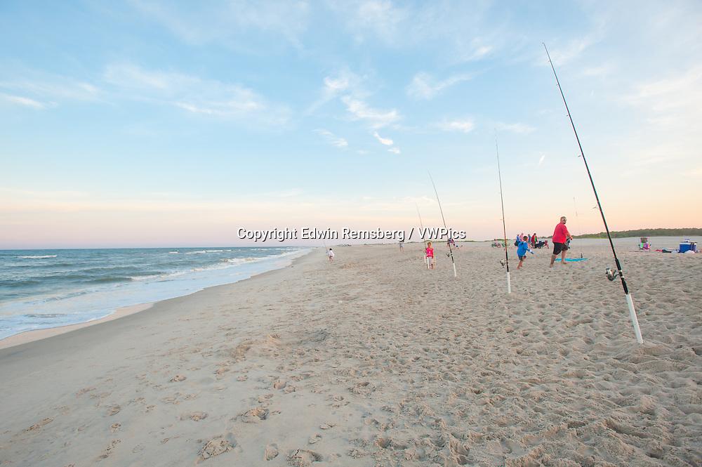 Families fishing at Assateague Island National Seashore, Maryland, USA