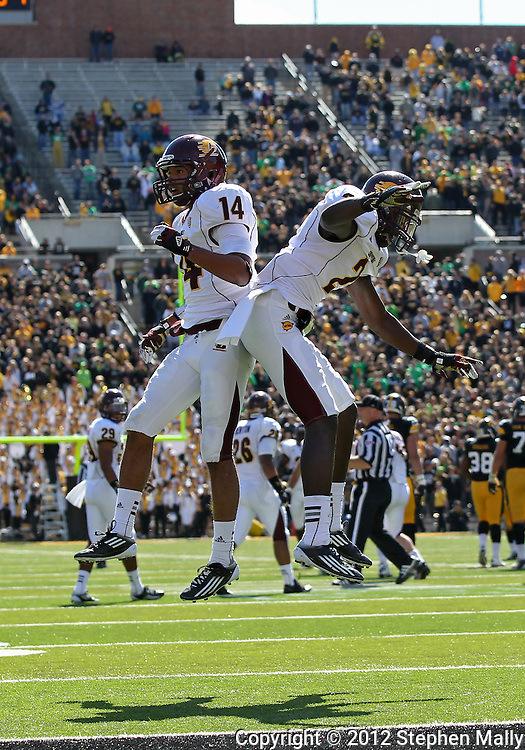 September 22 2012: Central Michigan Chippewas defensive back Jason Wilson (14) and Central Michigan Chippewas defensive back Lorenzo White (2) celebrate after a play during the second half of the NCAA football game between the Central Michigan Chippewas and the Iowa Hawkeyes at Kinnick Stadium in Iowa City, Iowa on Saturday September 22, 2012. Central Michigan defeated Iowa 32-31.