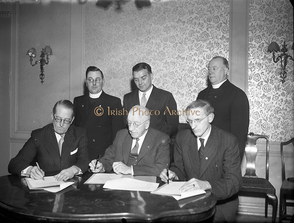 06/02/1957<br /> 02/06/1957<br /> 06 February 1957<br /> <br /> Aer Lingus Special - Signing Agreement re. Pilgrimage to Lourdes