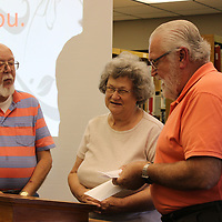 RAY VAN DUSEN/BUY AT PHOTOS.MONROECOUNTYJOURNAL.COM<br /> South Monroe County Community Fund board members Marty Hansen, left, and Jim Edwards present Evans Memorial Library's Barbara Blair a $5,066 check for technology improvements.