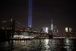 """NEW YORK, UNITED STATES - SEPTEMBER 10: 9/11 Memorial """"Tribute in Light"""" is seen in Manhattan skyline from Brooklyn Bridge Park in Brooklyn, New York, USA on September 10, 2016 on a day before the 15th anniversary of the 9/11 attacks. Mohammed Elshamy / Anadolu Agency  