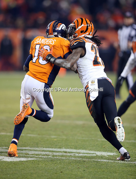 Cincinnati Bengals cornerback Dre Kirkpatrick (27) plays bump and run pass coverage on Denver Broncos wide receiver Emmanuel Sanders (10) during the 2015 NFL week 16 regular season football game against the Denver Broncos on Monday, Dec. 28, 2015 in Denver. The Broncos won the game in overtime 20-17. (©Paul Anthony Spinelli)