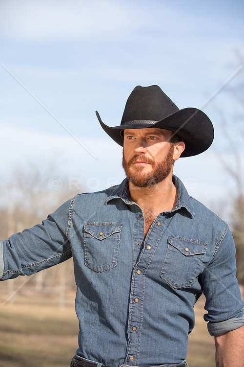 portrait of a handsome and rugged cowboy outdoors
