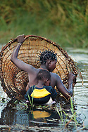 Hambukushu woman and child fishing, Okavango Delta, Botswana
